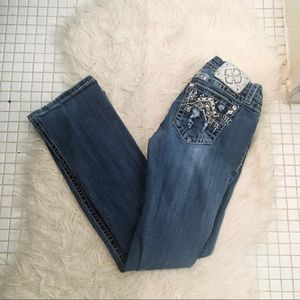 Miss Me Distressed Mid Rise Bootcut Jeans